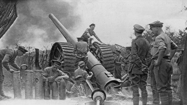 British Soldiers fire artillery rounds during World War I