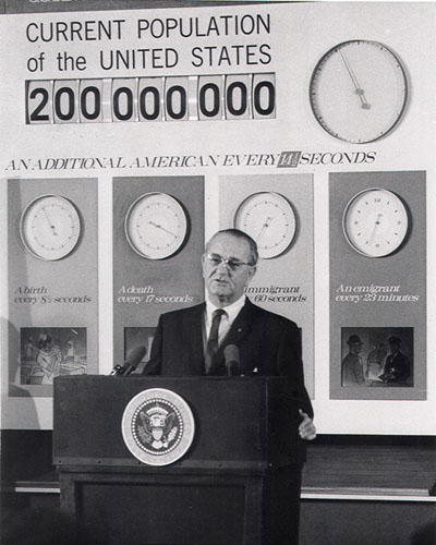 LBJ In Front Of Population Clock